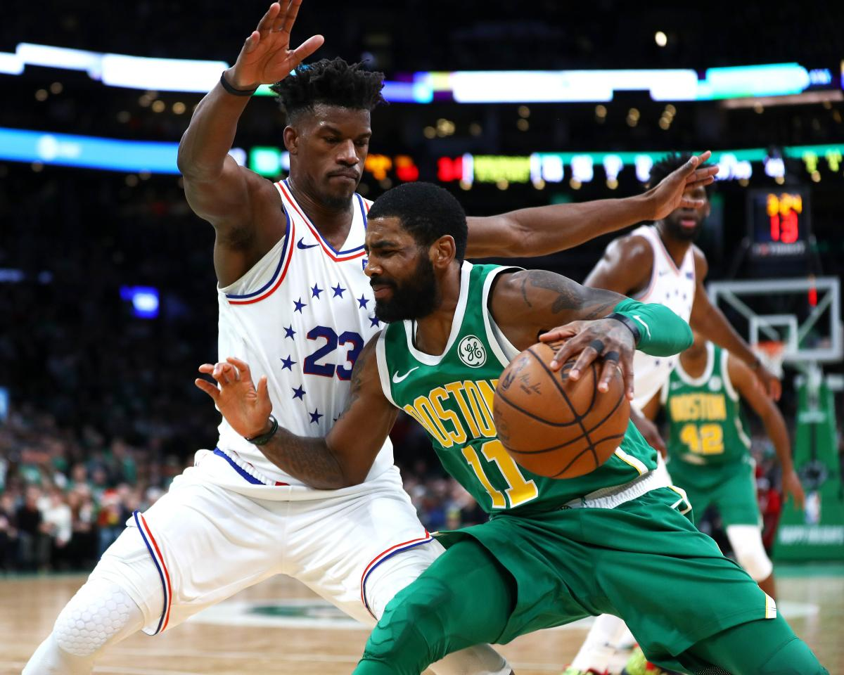 BOSTON, MASSACHUSETTS - DECEMBER 25: Kyrie Irving #11 of the Boston Celtics drives to the basket on Jimmy Butler #23 of the Philadelphia 76ers during the fourth quarter of the game at TD Garden on December 25, 2018 in Boston, Massachusetts. NOTE TO USER: User expressly acknowledges and agrees that, by downloading and or using this photograph, User is consenting to the terms and conditions of the Getty Images License Agreement. Omar Rawlings/Getty Images/AFP