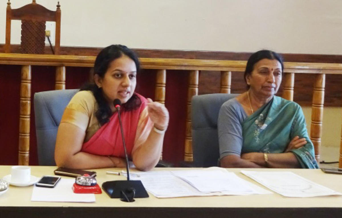 Deputy Commissioner P I Sreevidya and Madikeri City Municipal Corporation President Kaveramma Somanna take part in a meeting at the DC's office on Wednesday.