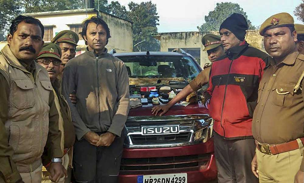 Golfer Jyoti Randhawa (2nd from left) arrested on charges of poaching in the Dudhwa Tiger Reserve protected area, in Bahraich district. PTI Photo
