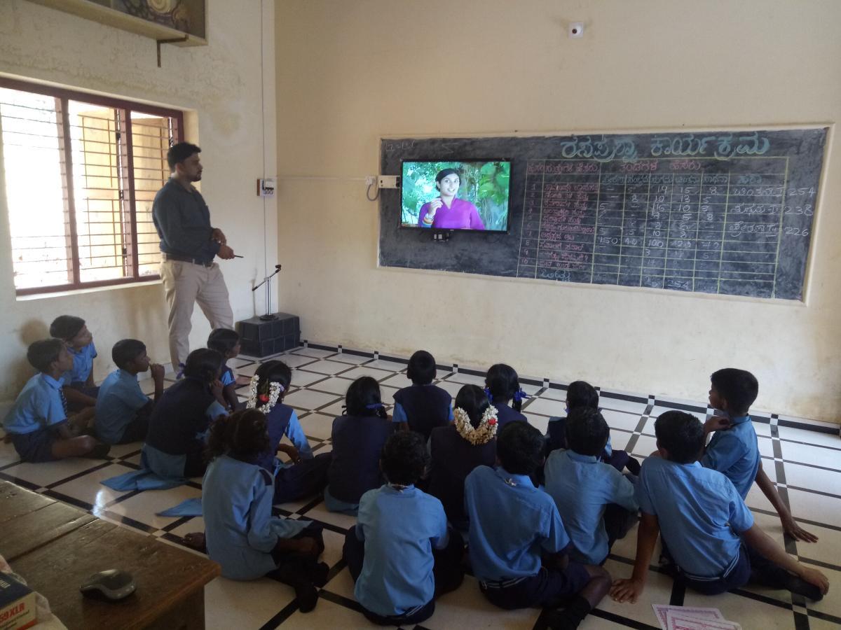 A teacher teaches at a smart classroom in Dakshina Kannada Zilla Panchayat Higher Primary School in Perabe, Puttur taluk.