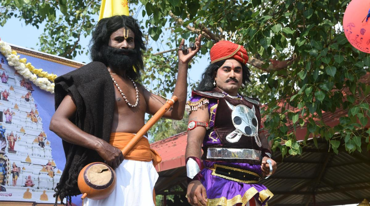 A man dressed as saint-poet Kanakadasa takes part in a procession during Kanaka Jayanti celebrations in Mangaluru.