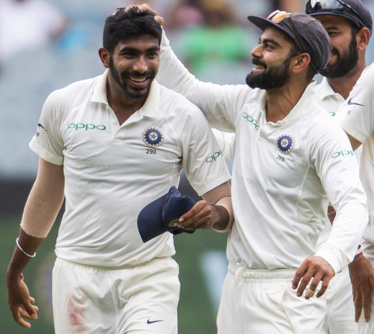 WELL DONE! India's Virat Kohli (right) celebrates with Jasprit Bumrah the dismissal of Australia's Shaun Marsh. AFP/PTI