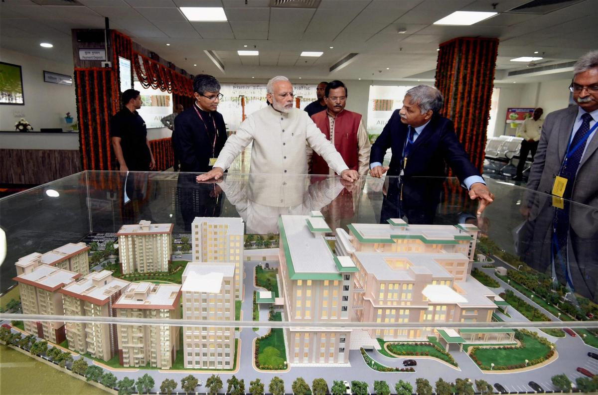 New Delhi: Prime Minister Narendra Modi being explained about the first ever All India Institute of Ayurveda after it was dedicated to the nation on the occasion of 2nd Ayurveda Day, in New Delhi on Tuesday. Minister of State for AYUSH (Independent Charge), Shripad Yesso Naik is also seen. PTI Photo / PIB