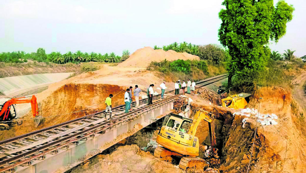 Earthmovers were pressed into service to clear landslideon the rail track near Tarikere in Chikkamagaluru district onFriday.