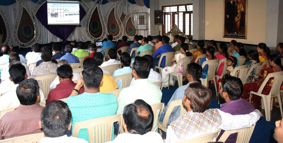 Prime Minister Narendra Modi addresses BJP workers through video conferencing in Hubballi on Friday.