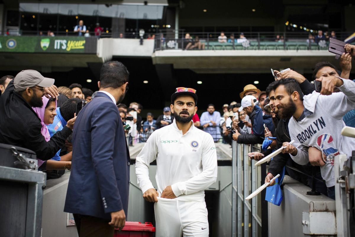 Melbourne : India's captain Virat Kohli walks up the player race during play on day five of the third cricket test between India and Australia in Melbourne, Australia, Sunday, Dec. 30, 2018. AP/PTI