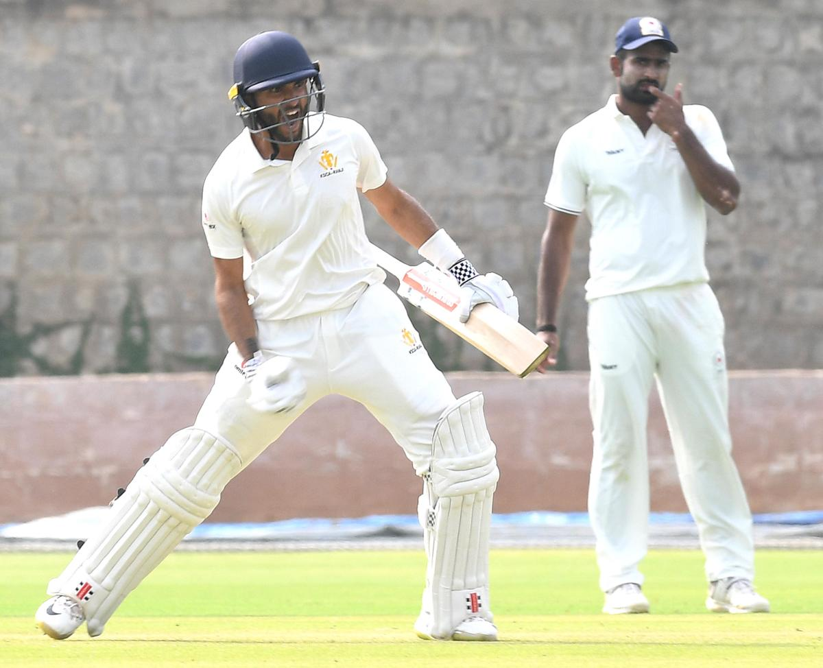 K V Siddharth of Karnataka exults after reaching his century against Chhattisgarh at the Alur ground in Bengaluru on Sunday. DH photo/ Srikanta Sharma R