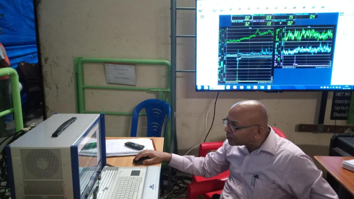 Prof Chandra Kishen analyses the strain display to check the strengh of the crossbeam at his lab in Indian Institute of Science on Sunday.
