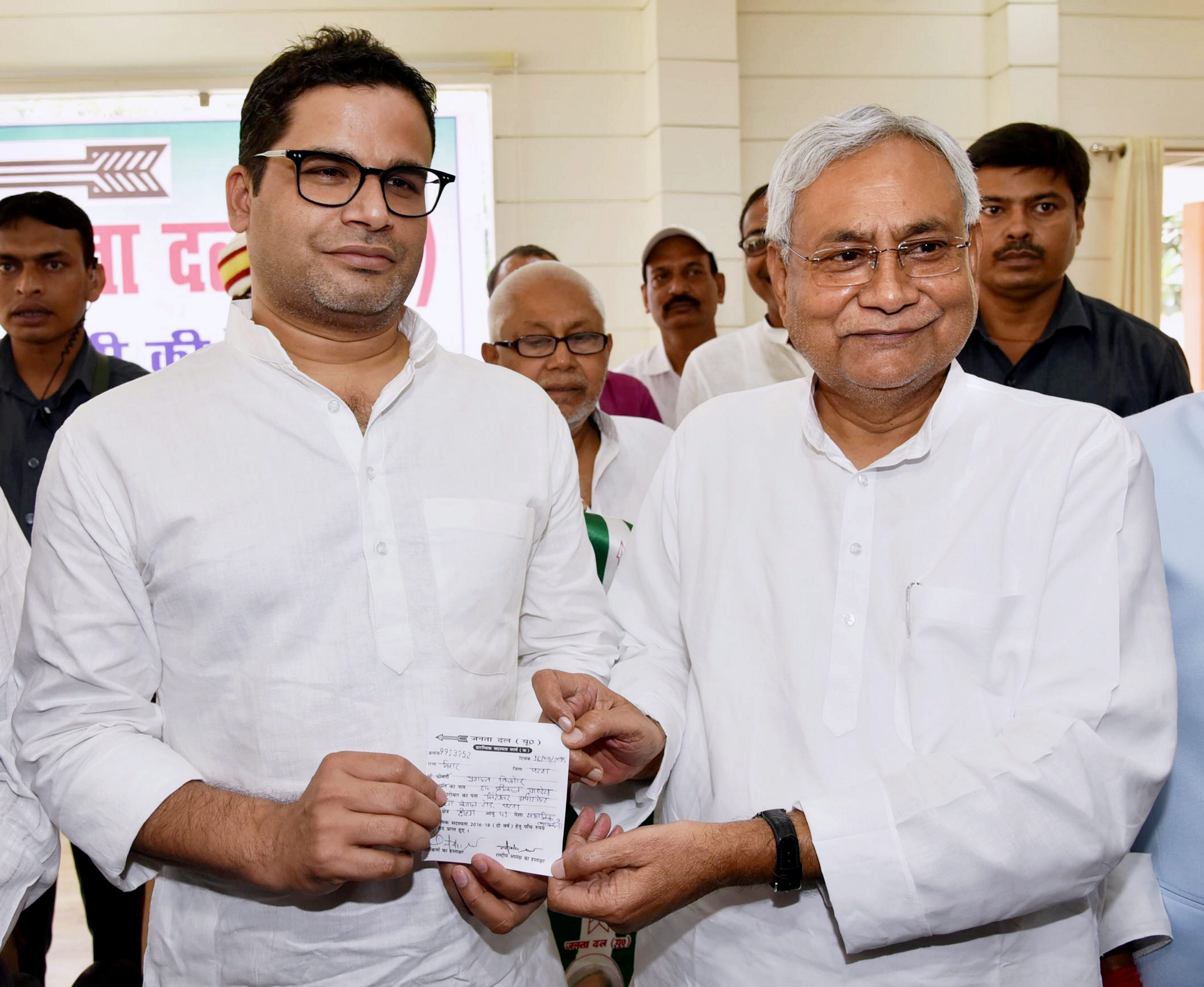 Bihar Chief Minister and Janta Dal United JD(U) National president Nitish Kumar greets electoral strategist Prashant Kishor after he joined JD(U) during party's state executive meeting at Anne Marg, in Patna, on September 16, 2018. PTI file photo
