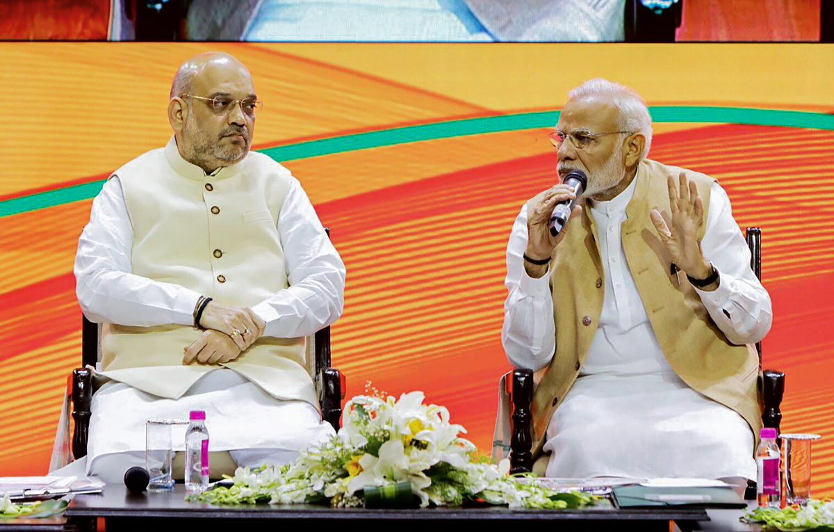Prime Minister Narendra Modi and BJP President Amit Shah during BJP National Executive meeting, in New Delhi, on Sunday. Twitter Photo via PTI
