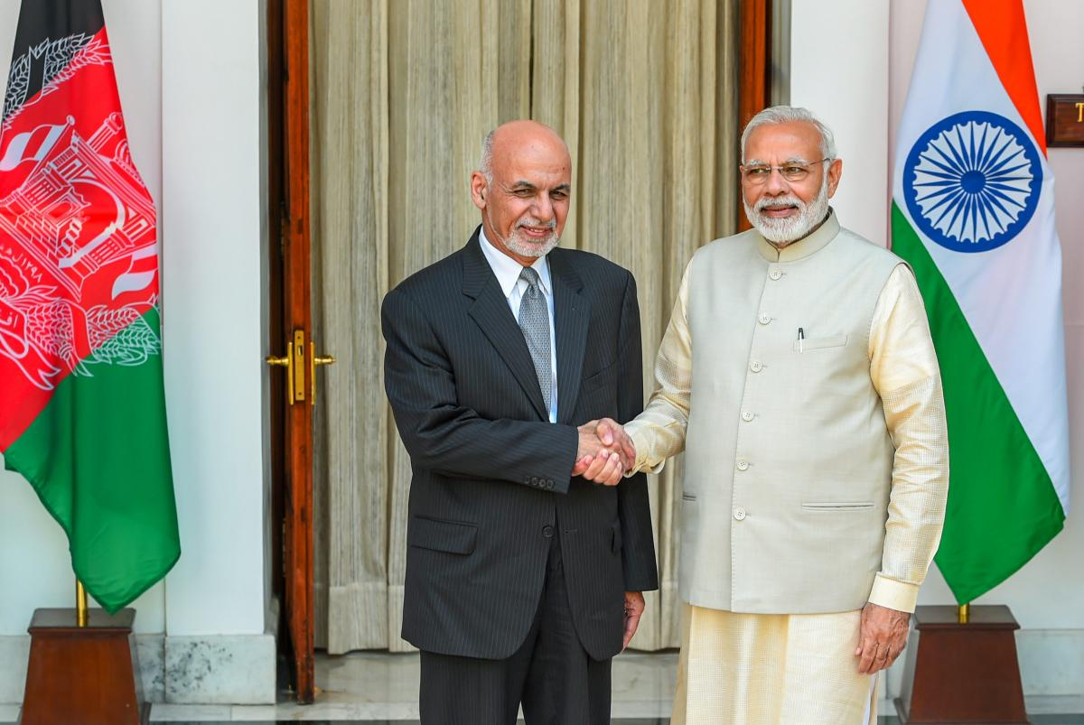 Prime Minister Narendra Modi (R) and Afghanistan President Ashraf Ghani ahead of a meeting at Hyderabad House, in New Delhi on Wednesday. PTI