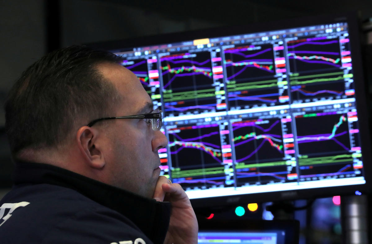 A trader looks at price monitors as he works on the floor at the New York Stock Exchange (NYSE) in New York City. Reuters file photo.