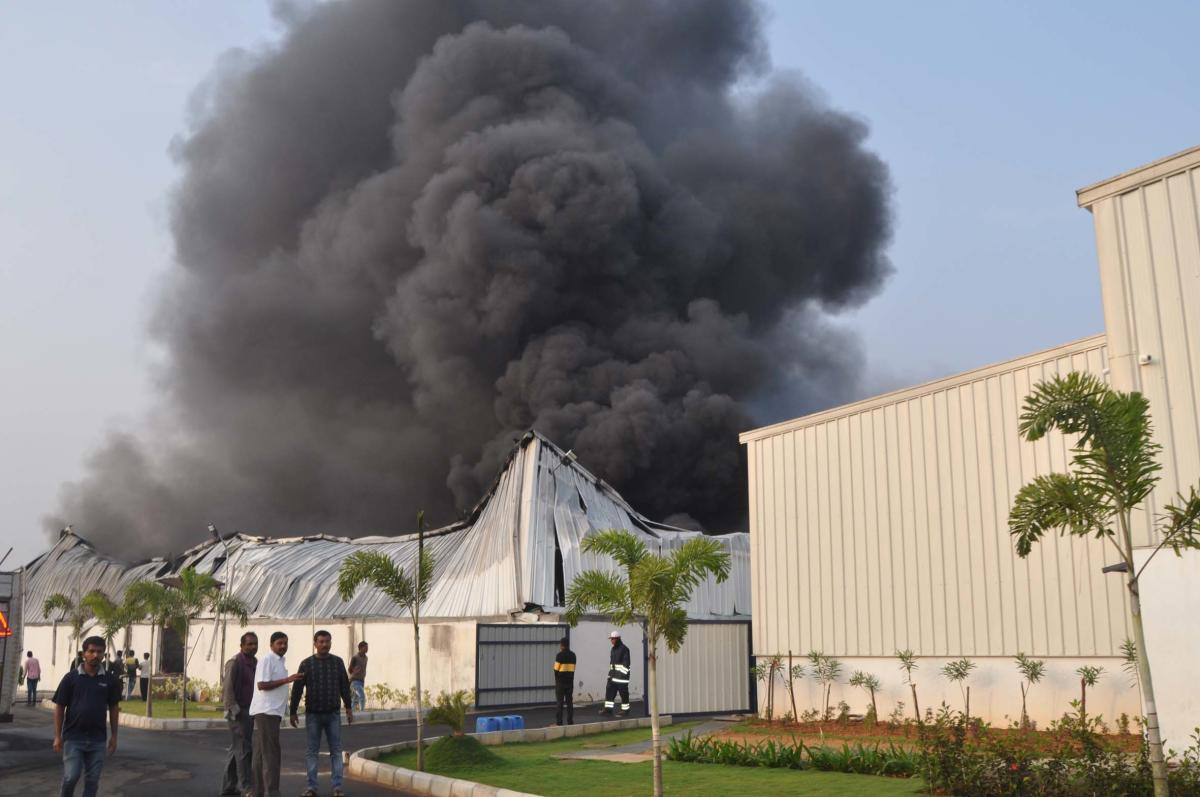 Smoke billows out of the factory at Tandya Industrial Area, in Nanjangud taluk, Mysuru district, on Monday.