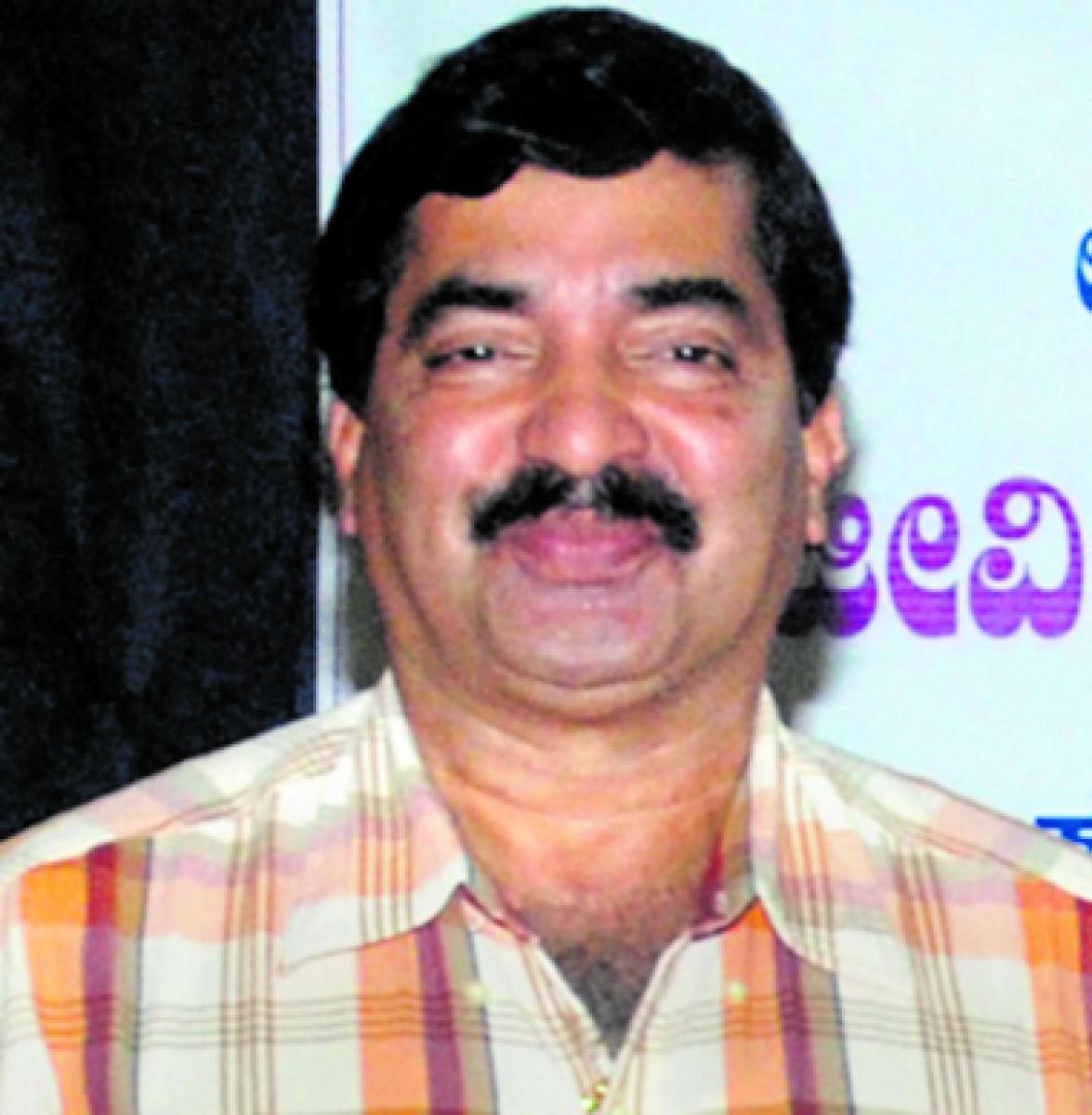 Dr M Mohan Alva