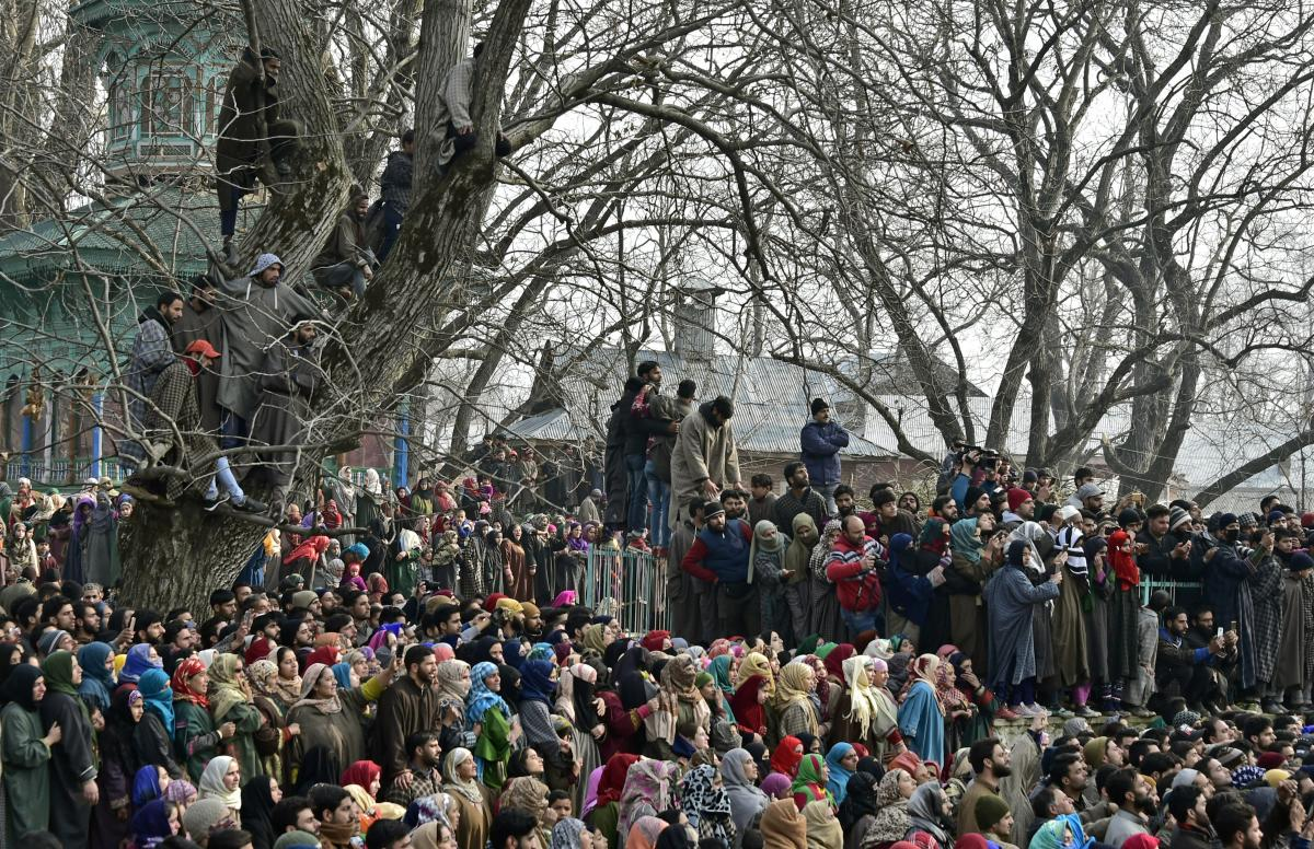 Villagers attend funeral prayers of four of the six militants of Ansar-ul-Ghazwat- ul- Hind, an offshoot of ISIS, who were killed in an encounter with army at Trall, in Pulwama on Dec. 22, 2018. (PTI File Photo)