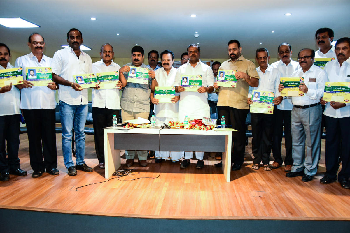 District In-charge Minister U T Khader releases the invitation of 'Rajatha Sambhrama' at SCDCC Bank in Mangaluru on Tuesday.