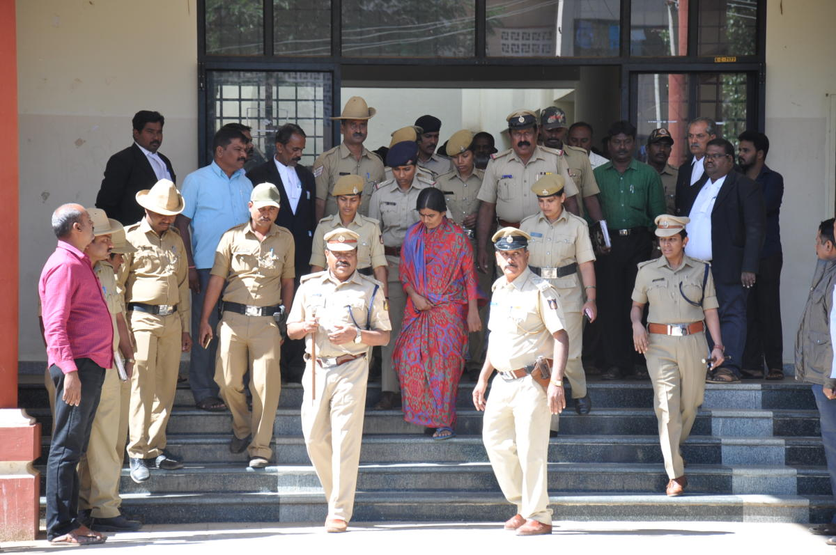 The accused in Sulvadi temple prasada poisoning case produced before the court, in Kollegal, on Thursday.