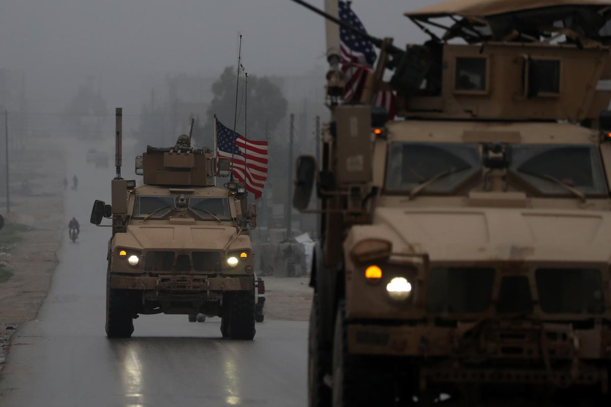 A line of US military vehicles in Syria's northern city of Manbij. (AFP File Photo)