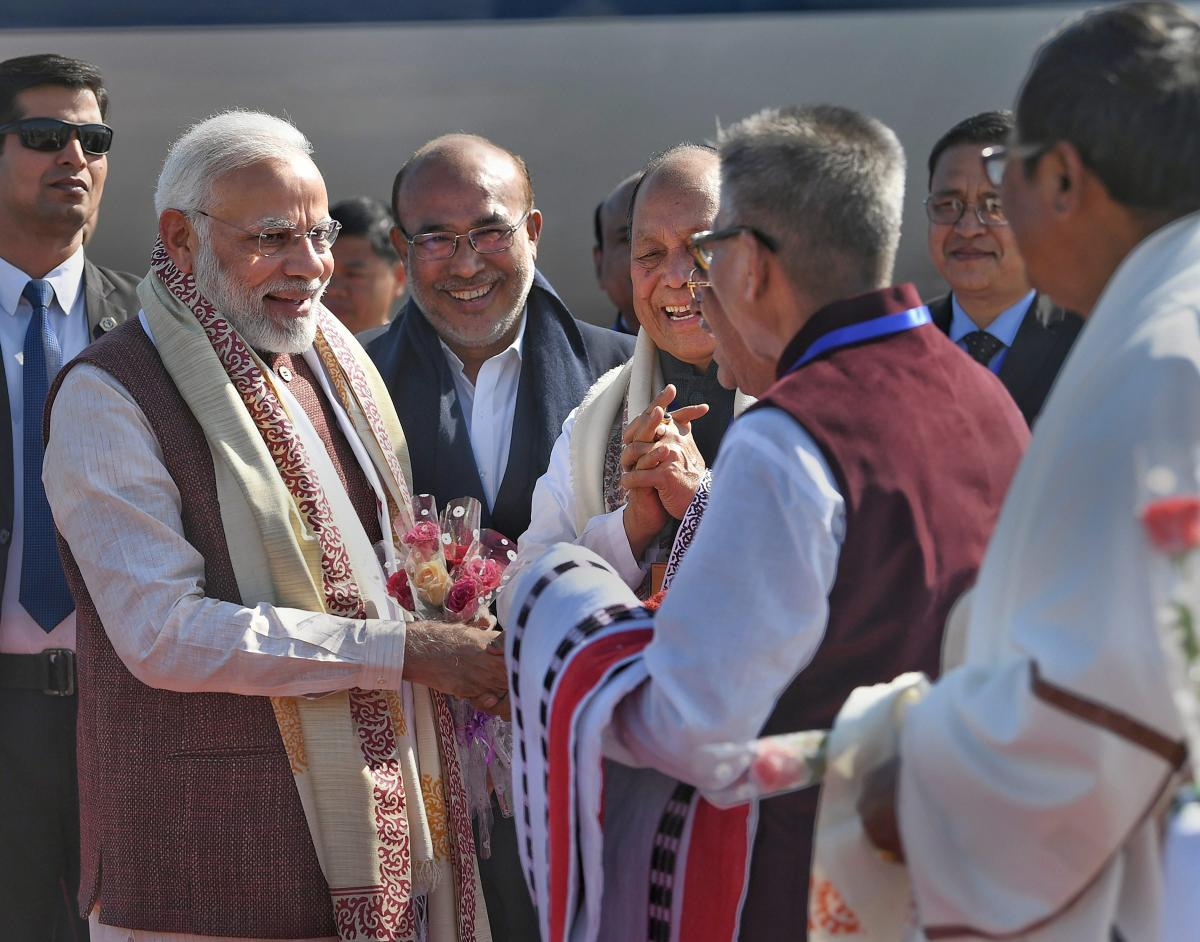 Prime Minister Narendra Modi being welcomed by the dignitaries on his arrival, in Imphal, Friday, Jan 4, 2019. (PIB Photo via PTI)