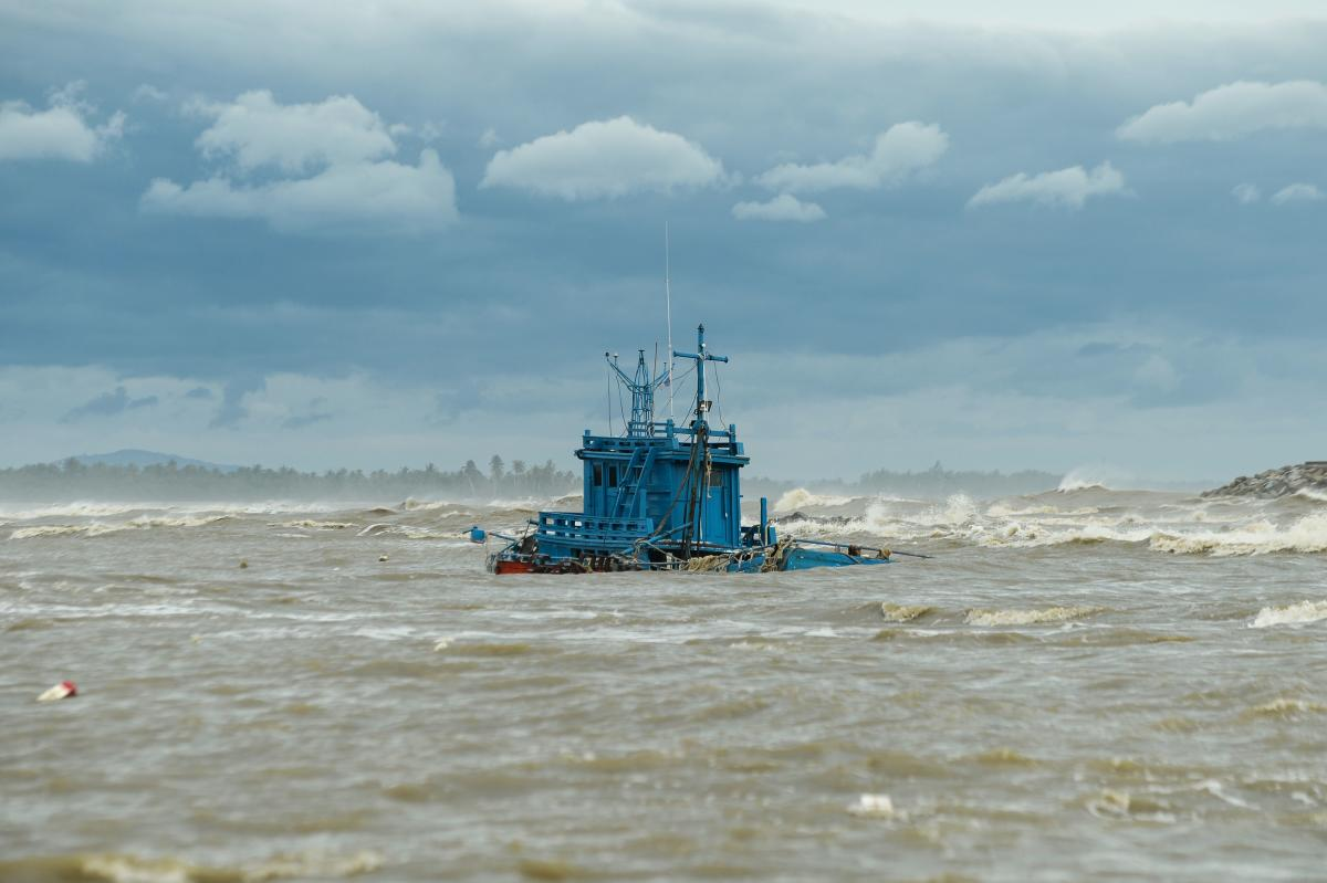 A fishing boat sinks because of high seas due to tropical storm Pabuk in the southern Thai province of Narathiwat on January 4, 2019. (AFP Photo)