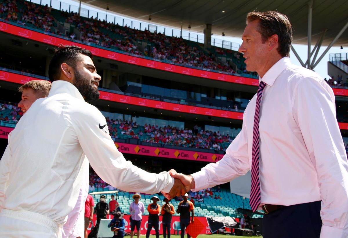 India's captain Virat Kohli (L) shakes hands with former Australian bowler Glenn McGrath before the start of the third day's play of the fourth and final cricket Test between India and Australia at the Sydney Cricket Ground on January 5, 2019. (AFP Photo)