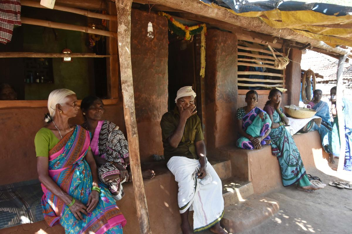 Fear stricken: The family of Beerappa (third from left) is crestfallen after losing two members to the monkey fever at Kanchikai village in Sagar taluk on Saturday. (Right) A nurse treats a resident at Aralagodu village in Sagar taluk. dh photos/Shivamogg