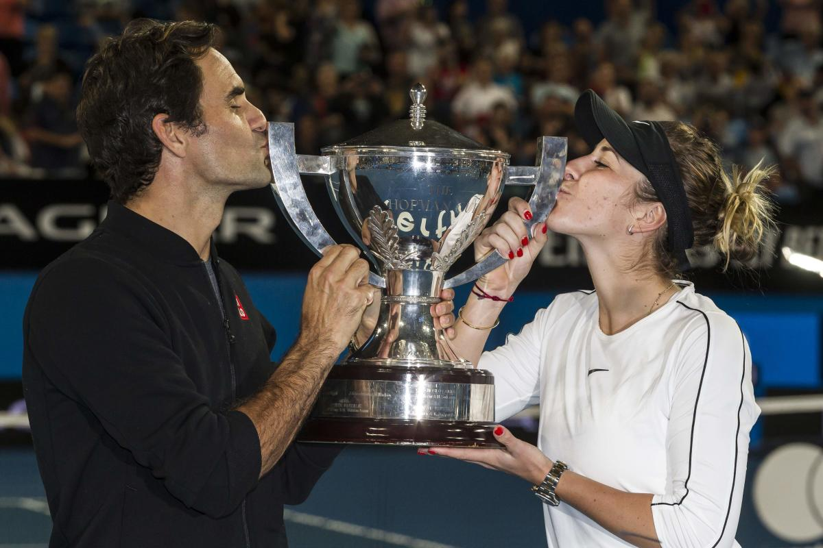 DOUBLE MAGIC: Switzerland's Roger Federer (left) and Belinda Bencic kiss the Hopman Cup after beating Germany in the final on Saturday. AFP