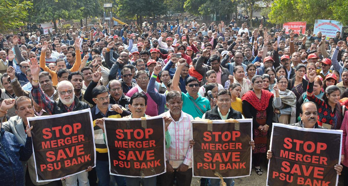 Bank employees stage a protest against the proposed merger of Vijaya Bank and Dena Bank with Bank of Baroda, during a nation-wide strike at JDA garden, in Jabalpur. PTI