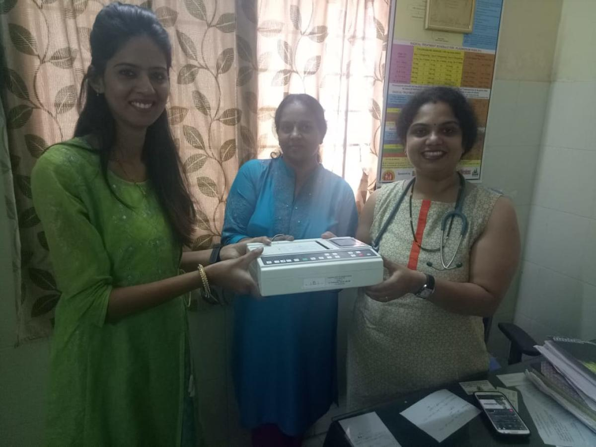 An ECG machine being handed over to a remote Primary Health Centre in Kodagu district.
