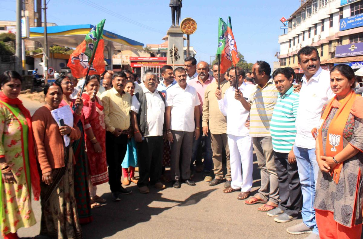 BJP workers stage a protest against the coalition government at General Thimayya Circle in Madikeri on Monday.