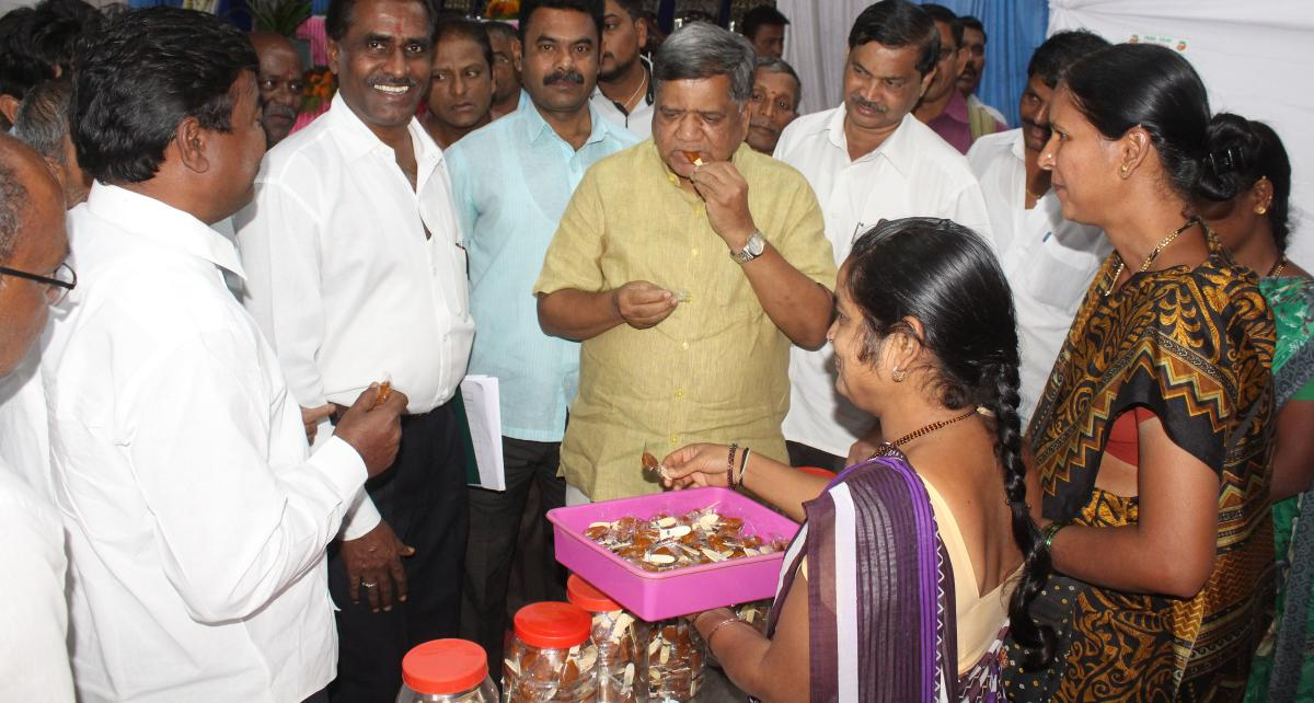 MLA Jagadish Shettar tastes 'chigali' at the Khadi and village industries exhibition which began at Indira Glass House in Hubballi on Monday.