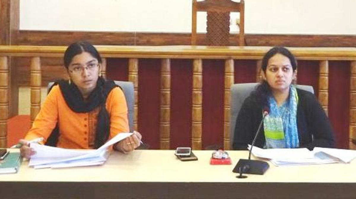 Deputy Commissioner P I Sreevidya chairs a meeting at her office on Monday. ZP CEO K Lakshmi Priya looks on.