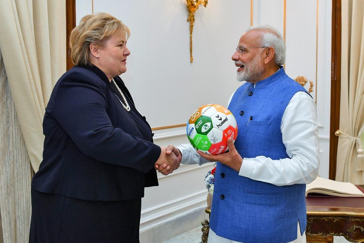 Prime Minister Narendra Modi gifts memento to his Norwegian counterpart Erna Solberg at Hyderabad House, in New Delhi, on Tuesday. PTI