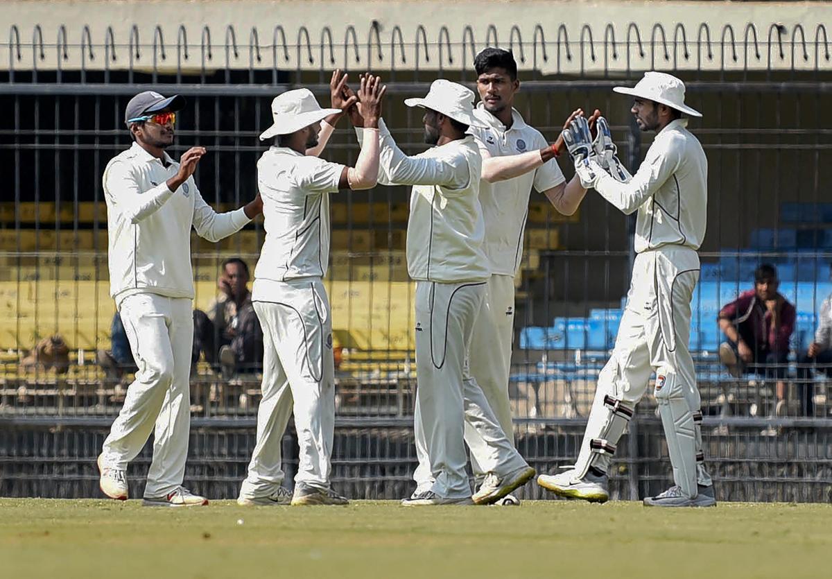K V Sasikanth (second from right) of Andhra is congratulated by team-mates after taking an MP wicket. PTI
