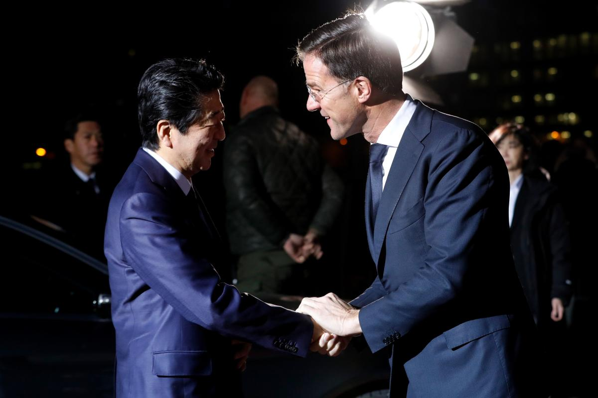Japanese Prime Minister Shinzo Abe (L) is welcomed by Dutch Prime Minister Mark Rutte on January 9, 2019, in Rotterdam, during a visit to the Netherlands. AFP