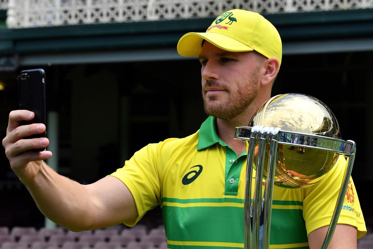 Australia's captain Aaron Finch takes a selfie with the ICC Cricket World Cup trophy in Sydney on Friday. AFP