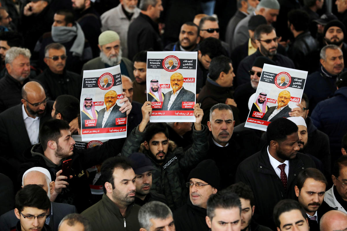FILE PHOTO: People holding pictures of Saudi journalist Jamal Khashoggi attend a symbolic funeral prayer for Khashoggi at the courtyard of Fatih mosque in Istanbul, Turkey November 16, 2018. REUTERS/Huseyin Aldemir/File Photo