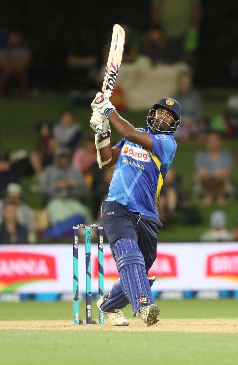VALIANT EFFORT: Sri Lanka's Thisara Perera clobbers one to the boundary during his blistering century against New Zealand on Saturday. AFP