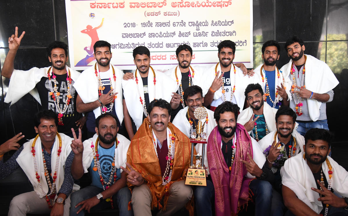 Karnataka men's team, winners of the 67th Senior National Volleyball championship in Bengaluru on Friday. STANDING (From left) Nakul Dev, Ganesh, Ravikumar, Karthik S A, Raison, Pratheek Shetty, Ashwal Rai. SITTING: P C Satish (Manager), Vishu Kumar (Asst coach), K R Lakshninarayana (coach), Darshan Gowda, Bharath, Karthik A, Vinayak, Sujith Acharya. DH Photo