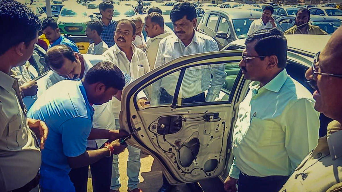 RTO officials remove the child lock system from a cab during a special drive.