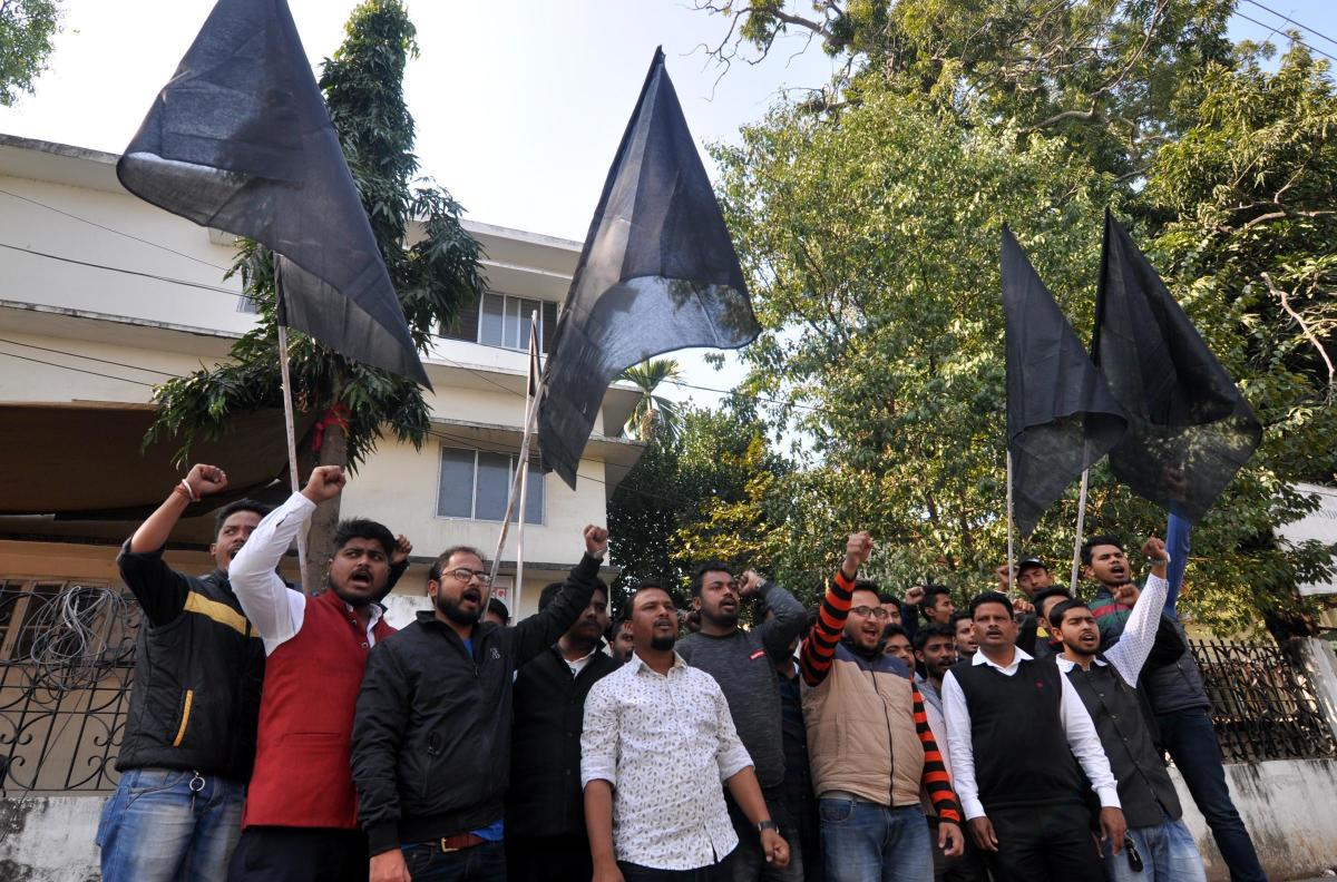 Members of All Assam Students' Union with black flags in Guwahati on Saturday. (Photo by Manash Das)
