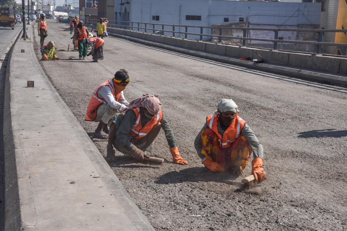 BBMP Workers busy in resurfacing work on Sri Bala Gangadharanatha Swamiji Flyover Road (Srisi circle flyover) in Bengaluru on Thursday. Photo by S K Dinesh