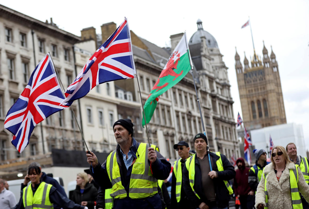 Protesters wearing yellow vests participate in a pro-Brexit demonstration march in central London. Reuters