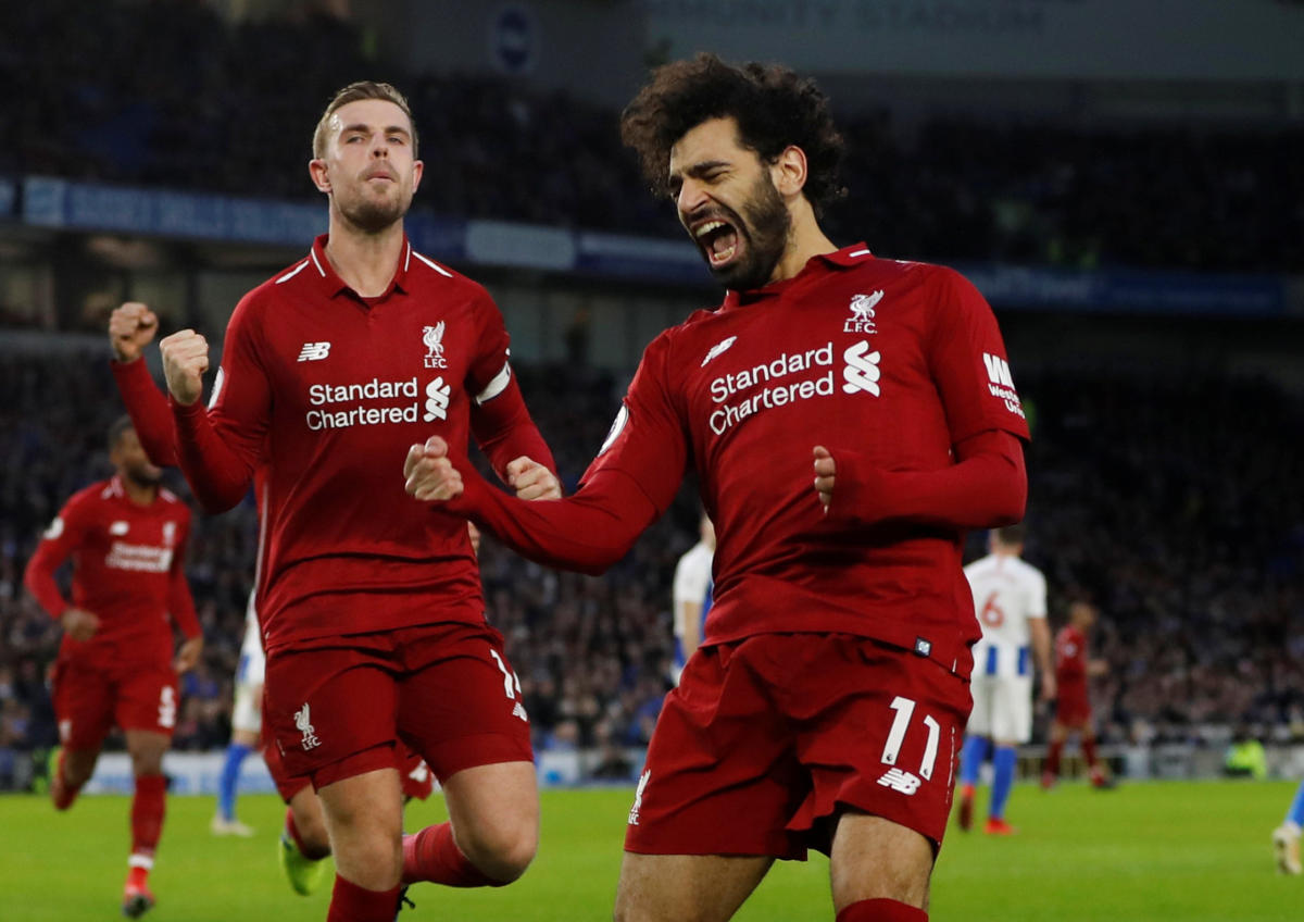 Liverpool's Mohamed Salah (right) celebrates with Jordan Henderson after scoring against Brighton. Reuters