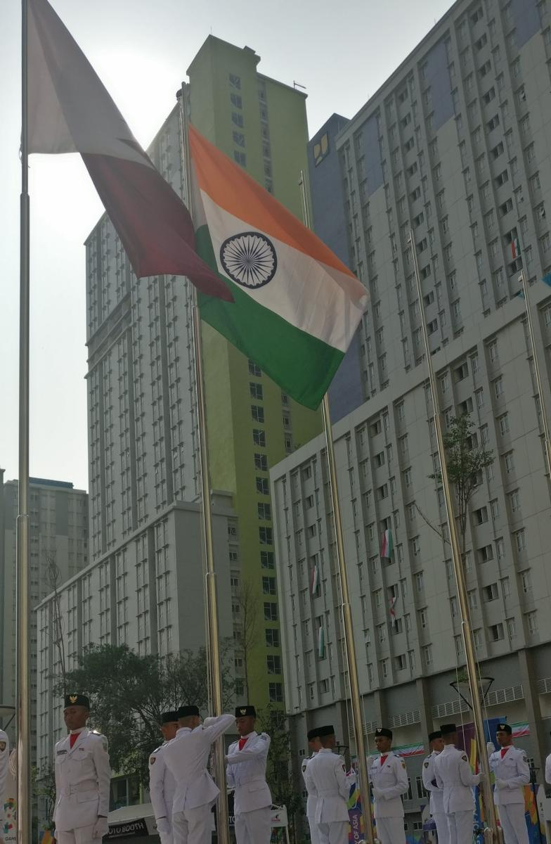 Indian flag being hoisted at the Asian Games' village in Jakarta. DH PHOTO