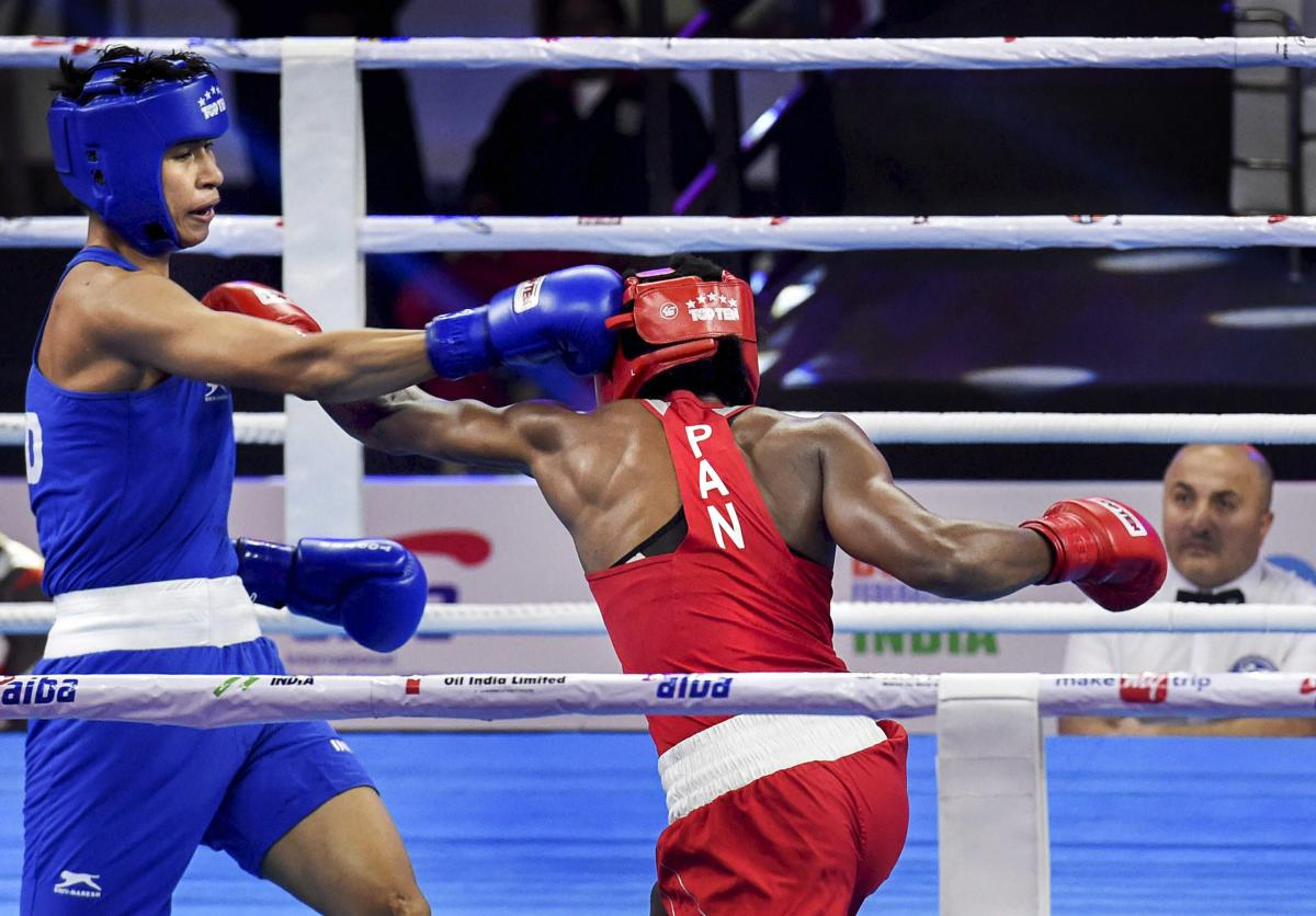 TAKE THAT!: India's Lovlina Borgohain (left) land a blow on Atheyna Bylon of Panama during the 69 kg pre-quarterfinal bout on Sunday. PTI