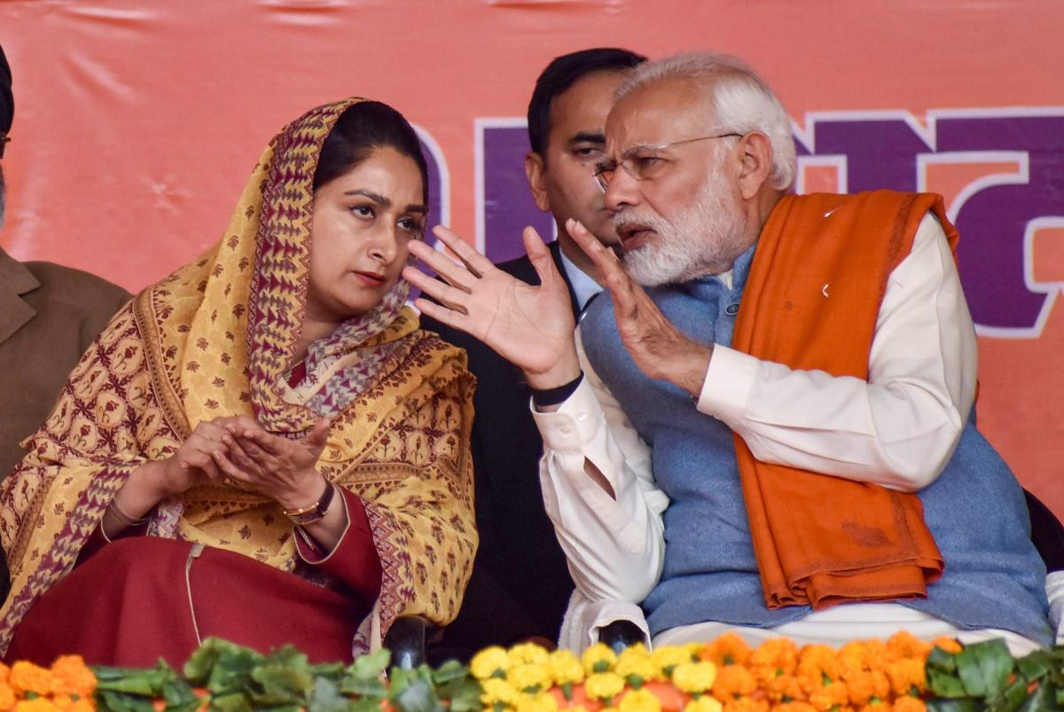 Prime Minister Narendra Modi with Union minister and SAD leader Harsimrat Kaur Badal during the 'Dhanwad Rally' at the PUDA ground in Gurdaspur on Thursday. PTI
