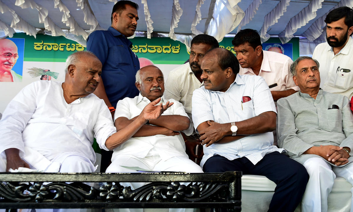 JD(S) president H D Deve Gowda, state president H Vishwanath, Chief Minister H D Kumaraswamy and MLC Basavaraj Horatti have a chat at a party meeting in Bengaluru on Thursday. DH Photo
