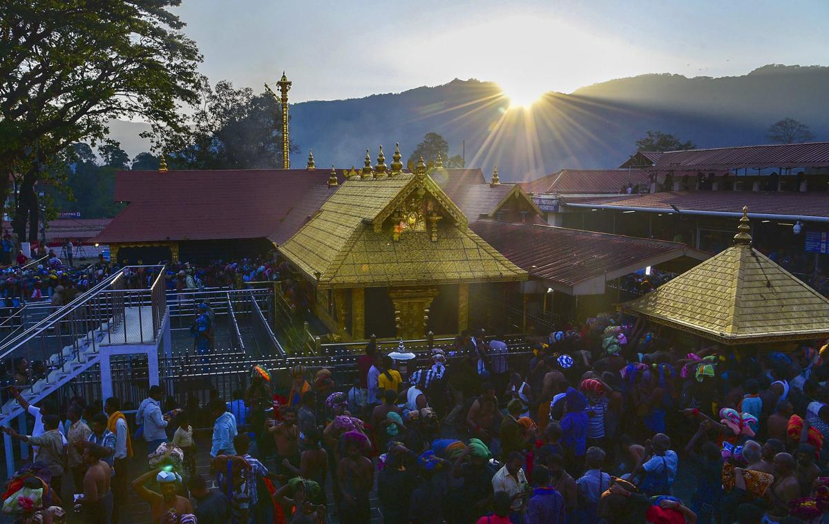 Devotees arrive to offer prayers at the Lord Ayyappa temple in Sabarimala. PTI file photo