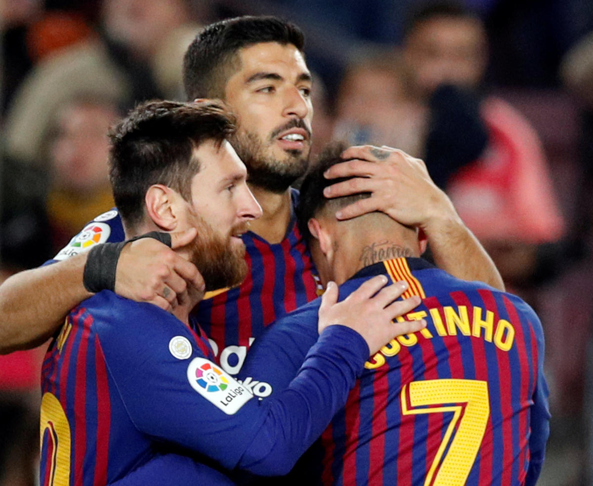 Brilliant Barcelona's Luis Suarez (centre) celebrates with team-mates Lionel Messi (left) and Philippe Coutinho after scoring against Eibar. REUTERS